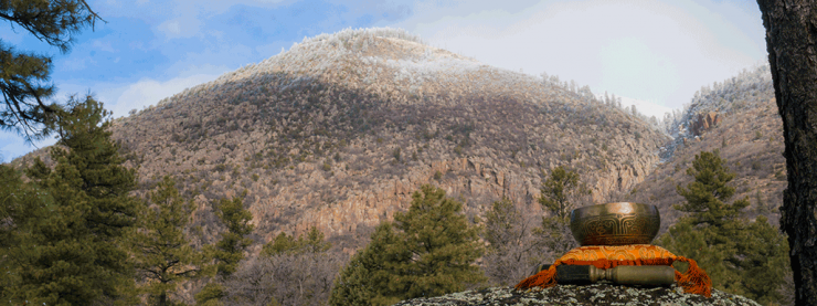 Mount Elden with snow, meditation bell set in foreground